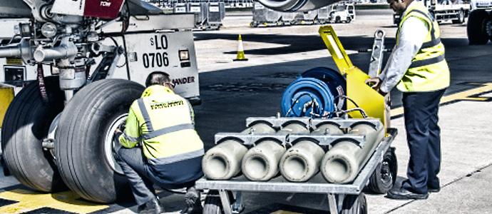 hose reel being used to inflate aircraft tyre