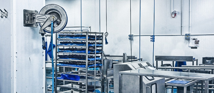 hose reel being used in a food production area